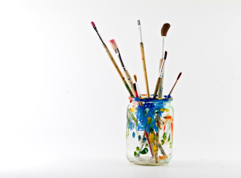 artists brushes in a jar isolated on white